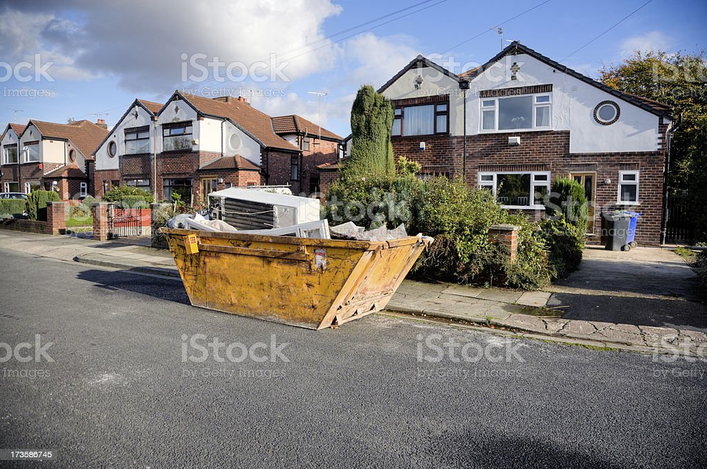 Suburban Street. Skip or Dumpster outside Semi-detached House.More Below royalty-free stock photo