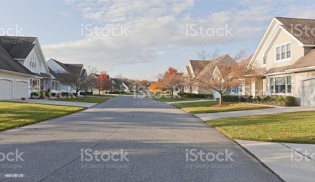 Suburban Street with Uniform Residential Housing stock photo