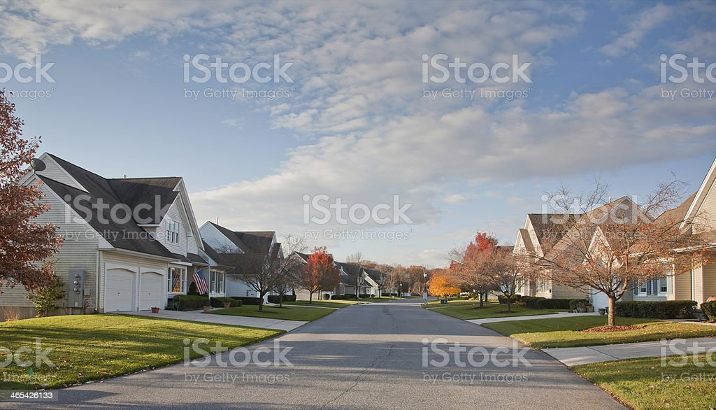 Suburban Street with Uniform Residential Housing stock photo
