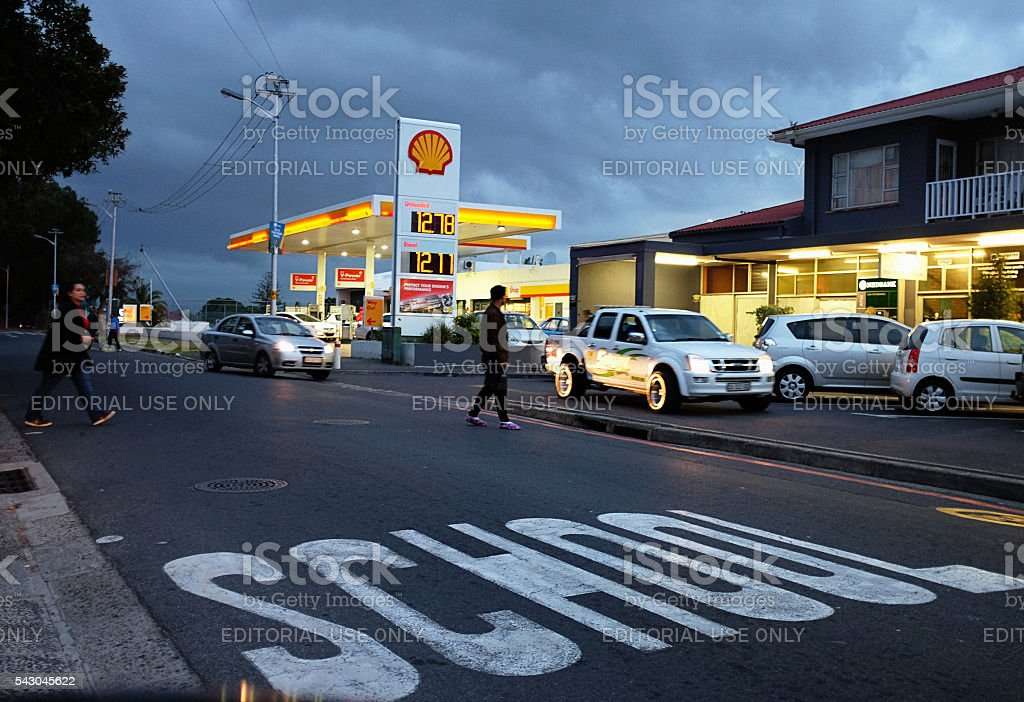 Suburban strip mall at sunset with Shell gas statkion stock photo