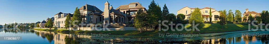 Suburban sunrise luxury lakeshore living Florida royalty-free stock photo