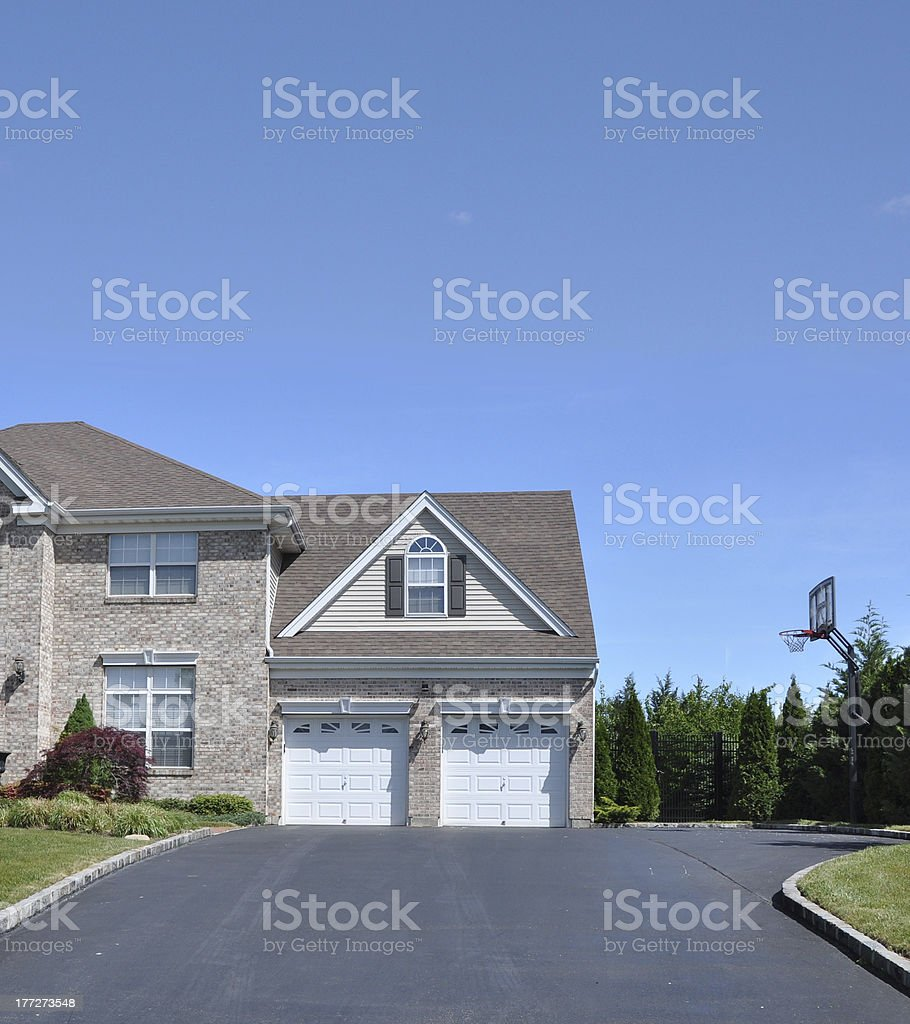 SuburbanTwo Car Garage Basketball Hoop Driveway stock photo