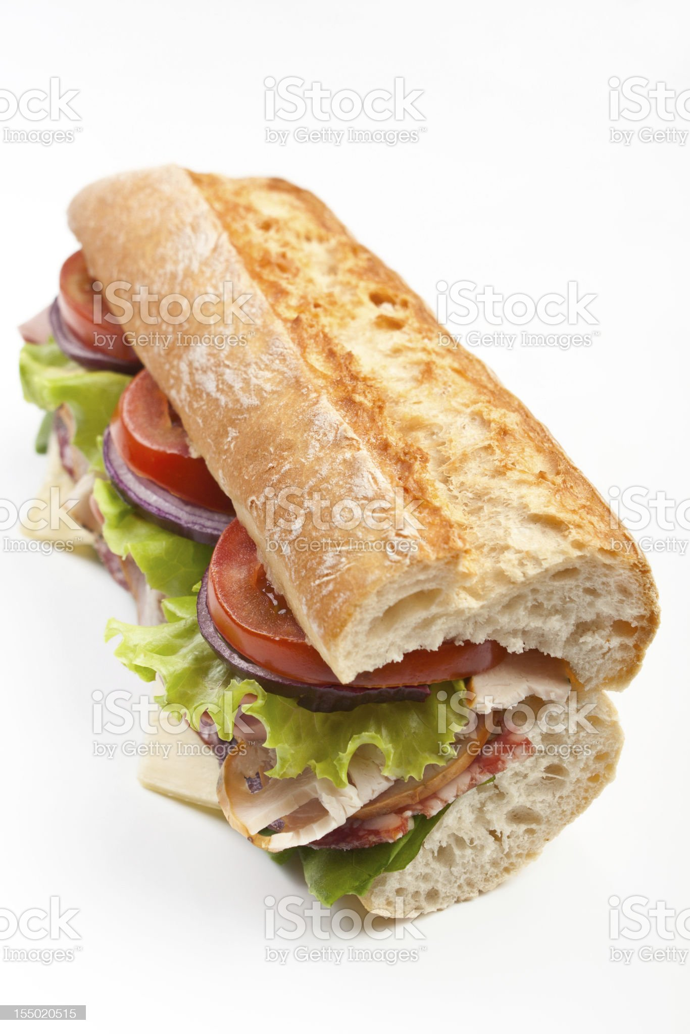 Subway baguette sandwich with three tomatoes and lettuce royalty-free stock photo