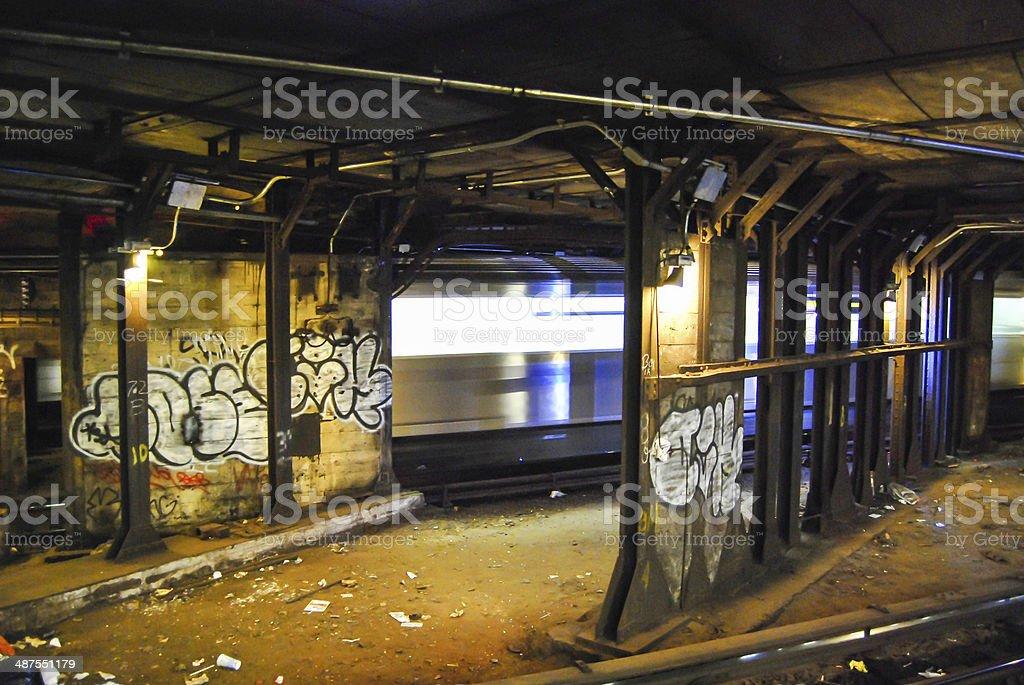 Subway Graffiti with Passing Train stock photo