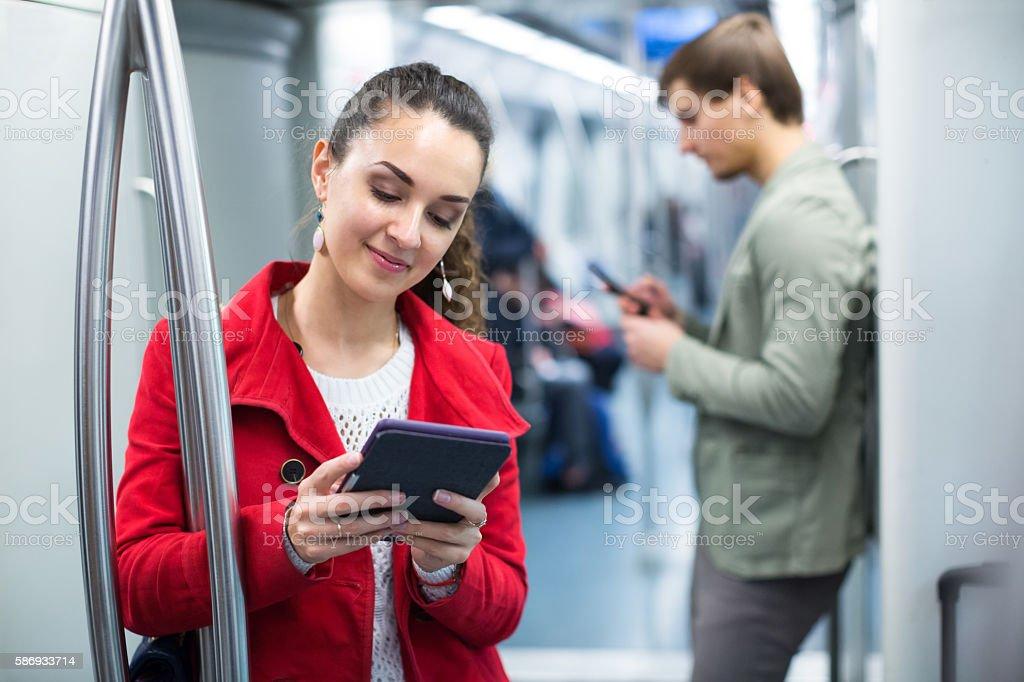 subway passengers with phones stock photo