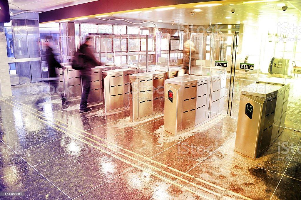 Subway station gate, motion blurred passengers royalty-free stock photo