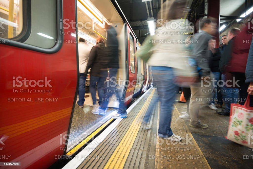Subway station platform, train with doors open stock photo