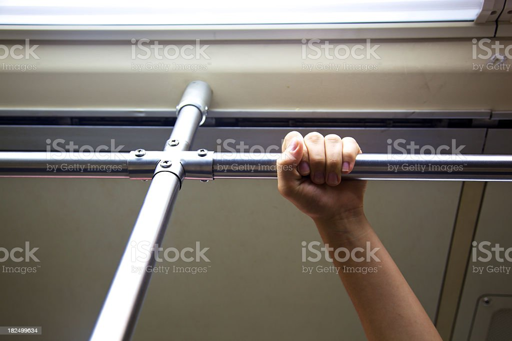 Subway Symbol of Public Transportation Hand Holding Rail royalty-free stock photo