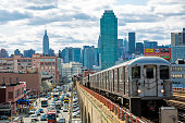 Subway Train Approaching  Elevated Subway Station in Queens, New York