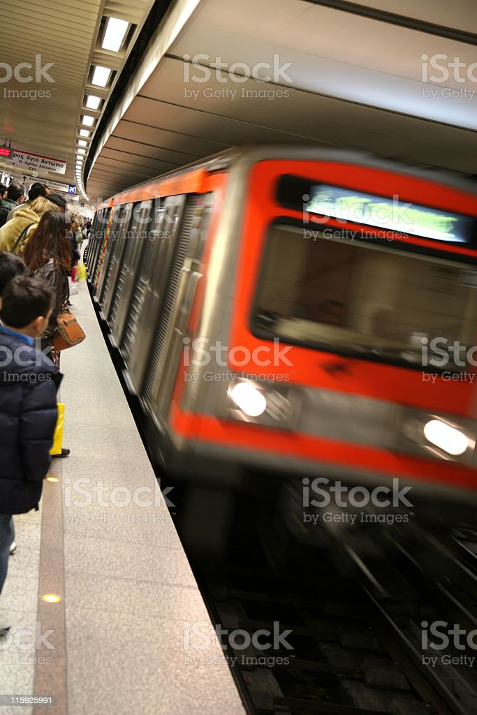 A subway train arriving at the platform royalty-free stock photo