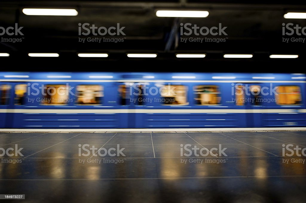 Subway train at platform in motion blur. royalty-free stock photo