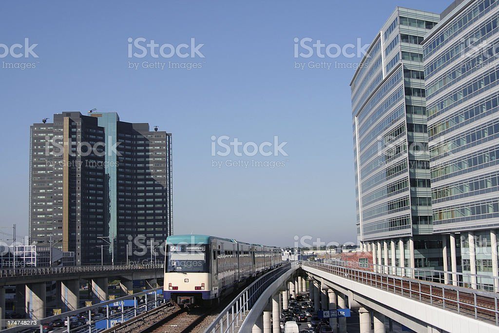 Subway train between office buildings royalty-free stock photo