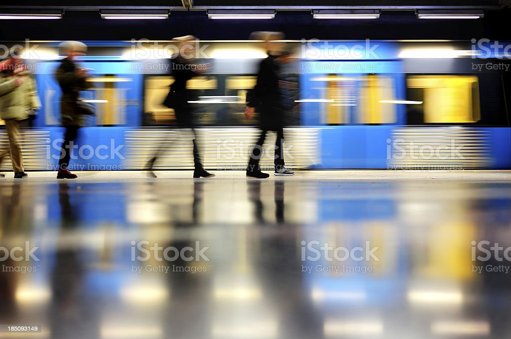 Subway train in profile, and commuters stock photo