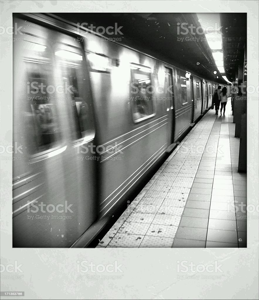 NYC Subway Train Leaves Station in Motion Blur royalty-free stock photo