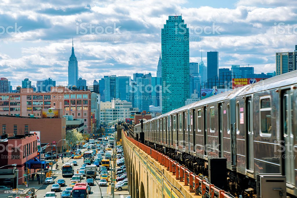 Subway Train Speeding on Elevated Track in Queens, New York stock photo