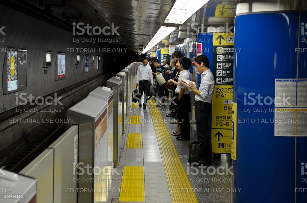 Subway train station platform with commuters in Tokyo Japan stock photo