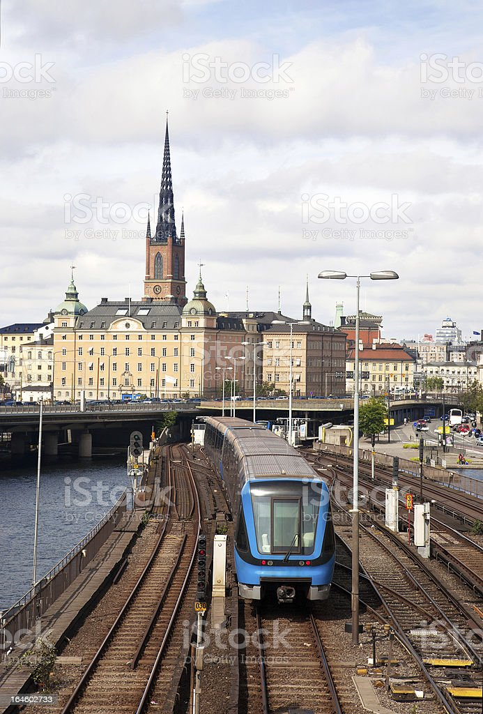 Subway train with Stockholm old city in the background. stock photo