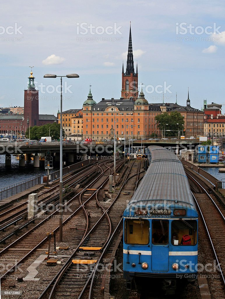 Subway train with Stockholm old city in the background stock photo