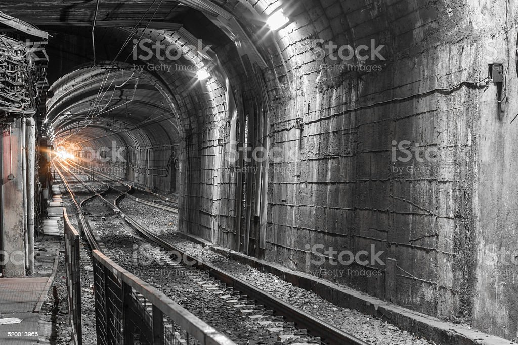 Subway tunnel, train at the end of the tunnel stock photo