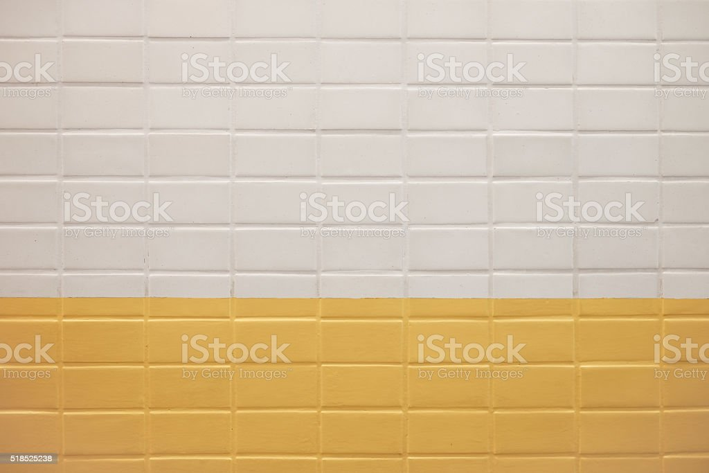 Subway wall background with white and yellow tiles texture stock photo