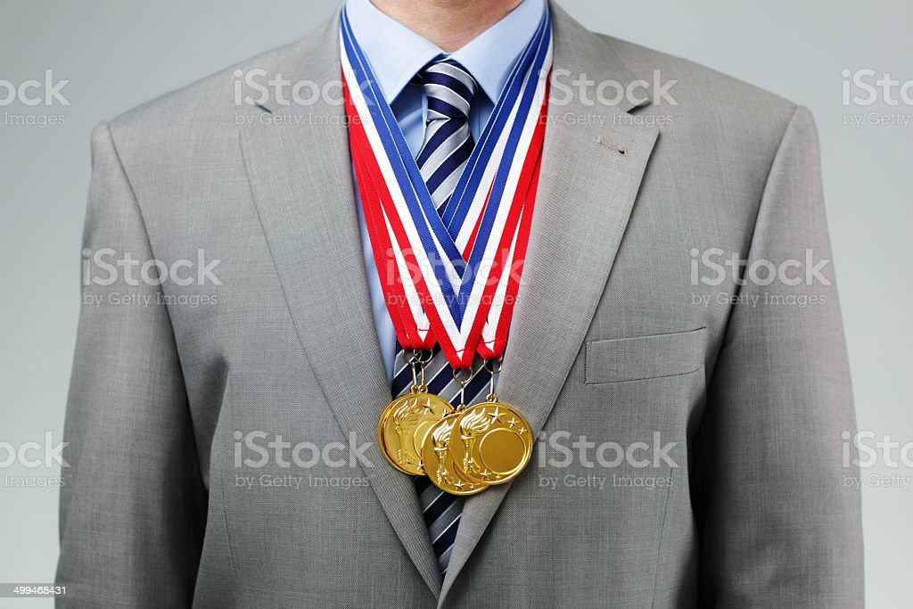 Succesful businessman with gold medals stock photo