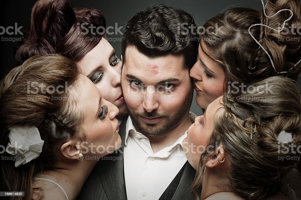 Succesful latin lover, a groom with four brides. stock photo