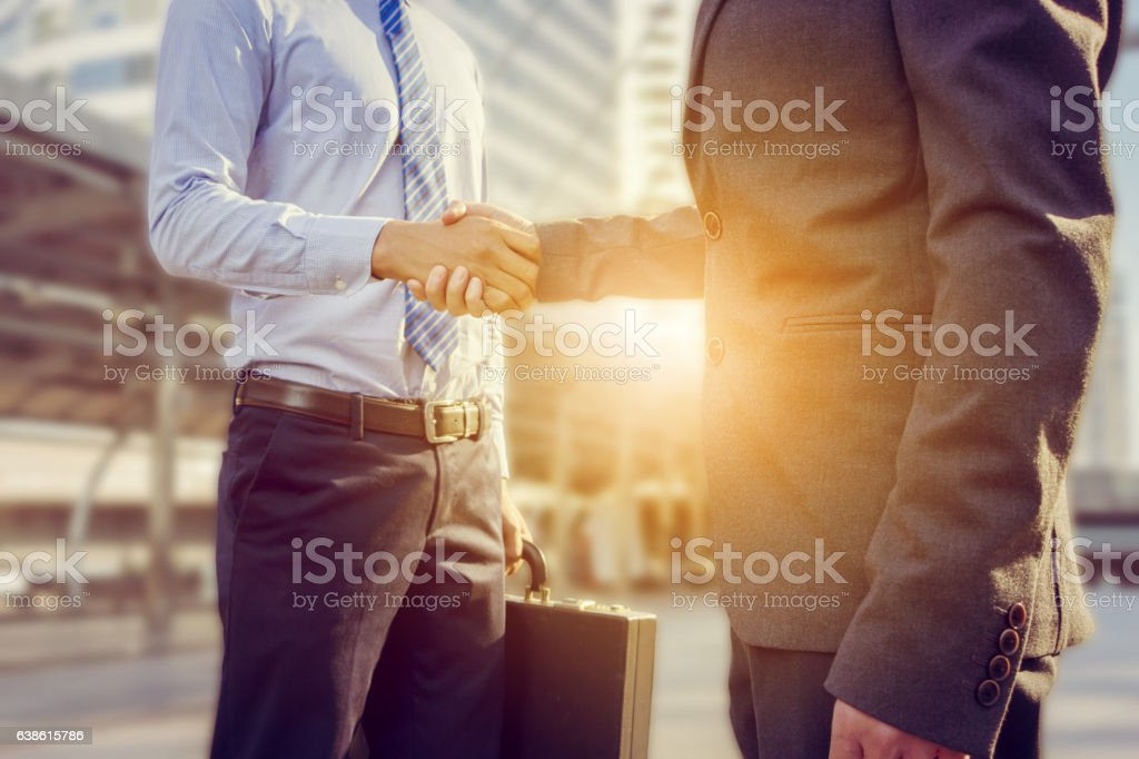 Success and Happiness concept, Businessman handshake at city outside office. stock photo