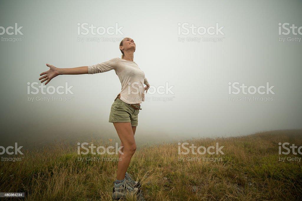 Success at mountain top-Woman hiking stock photo
