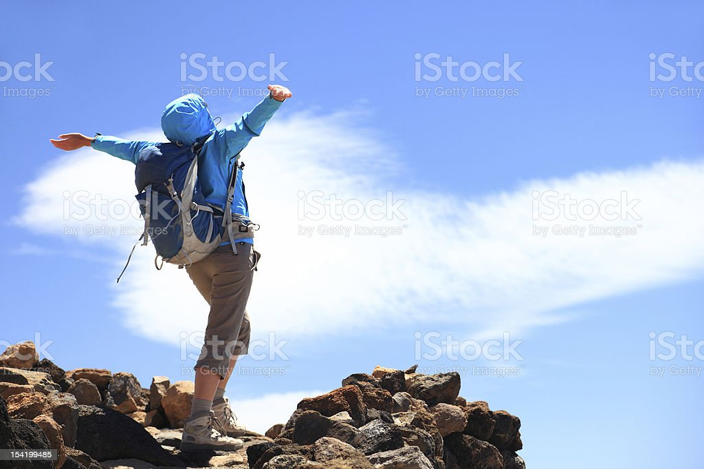 Success at top of mountain stock photo