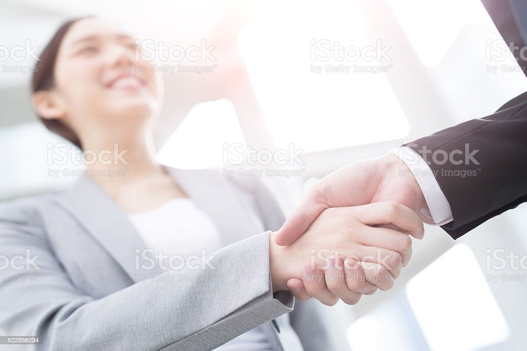 success business people shake hands stock photo