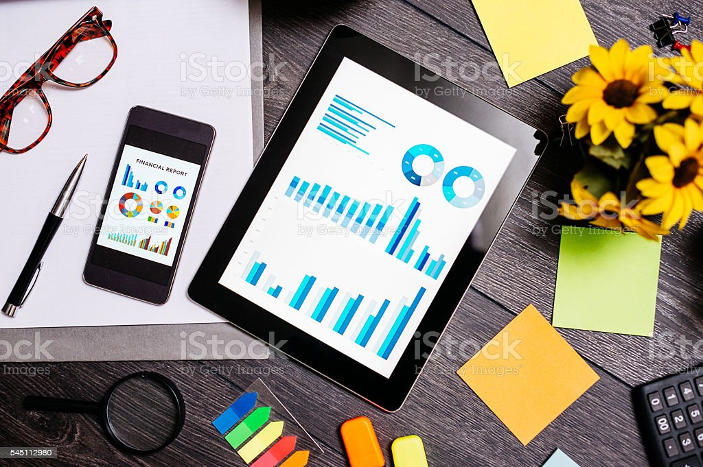 Success charts and graphs in modern office stock photo