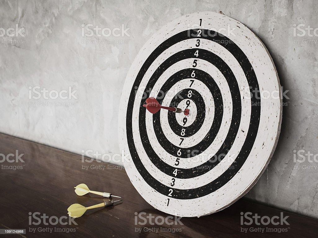 Success concept, darts hit target on dartboard royalty-free stock photo