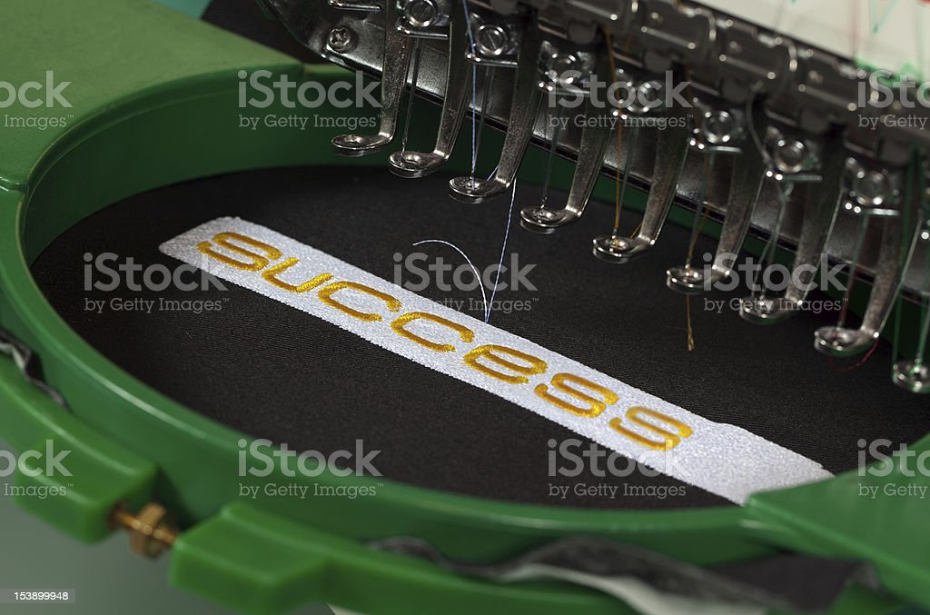 Success embroidery stock photo