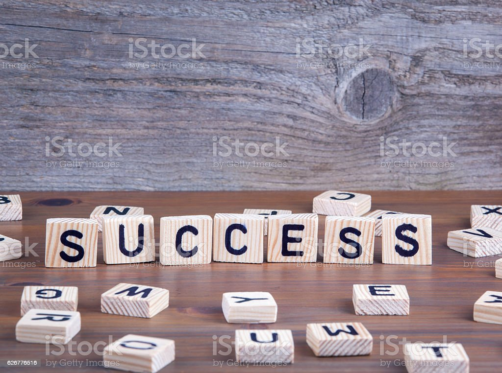 Success from wooden letters on wooden background stock photo