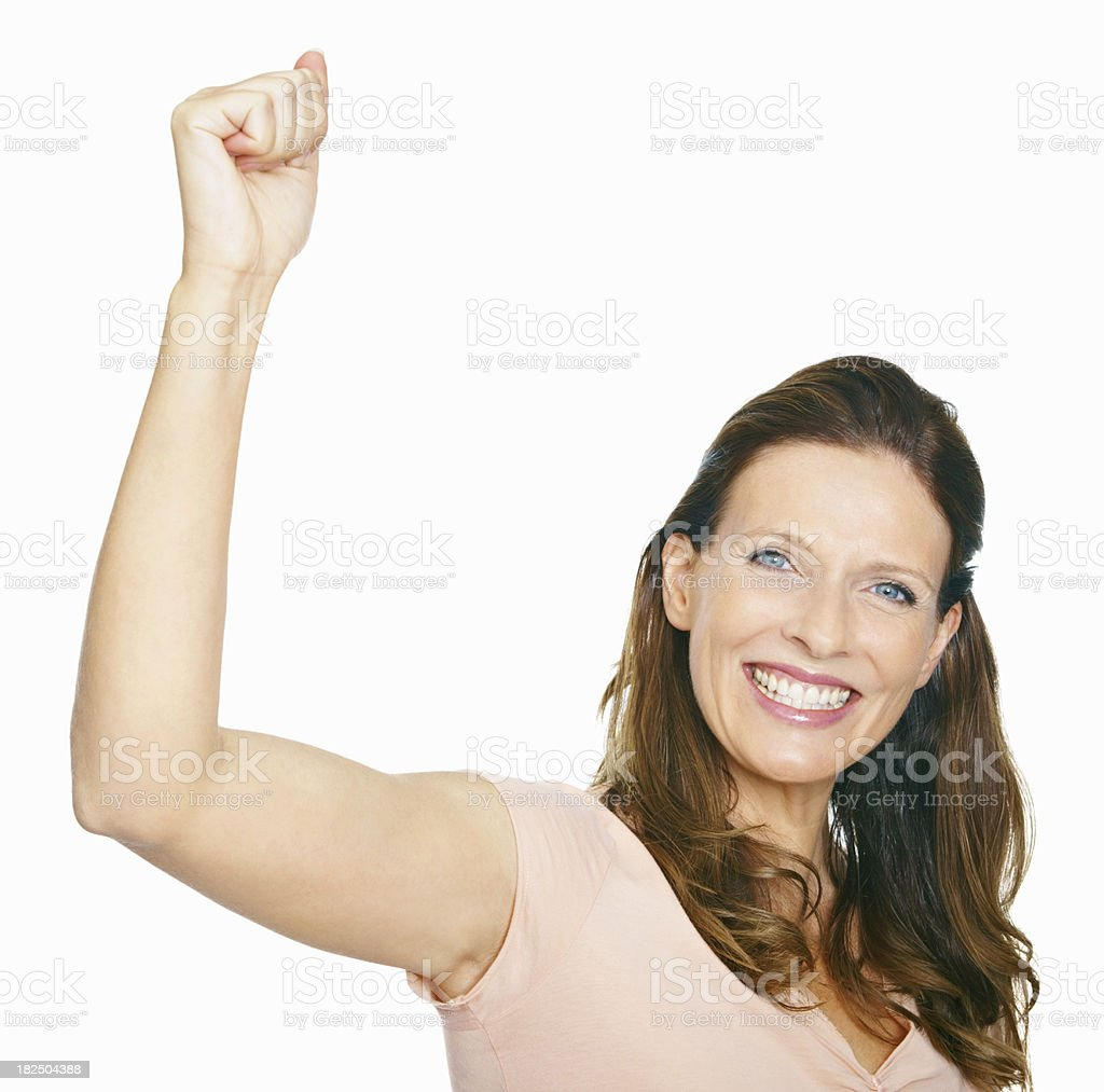 Success - Happy mature woman with clenched fist royalty-free stock photo