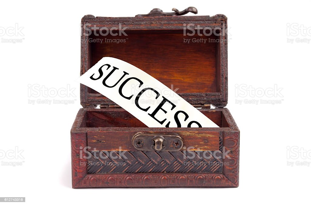Success jump from a decorative wooden chest stock photo