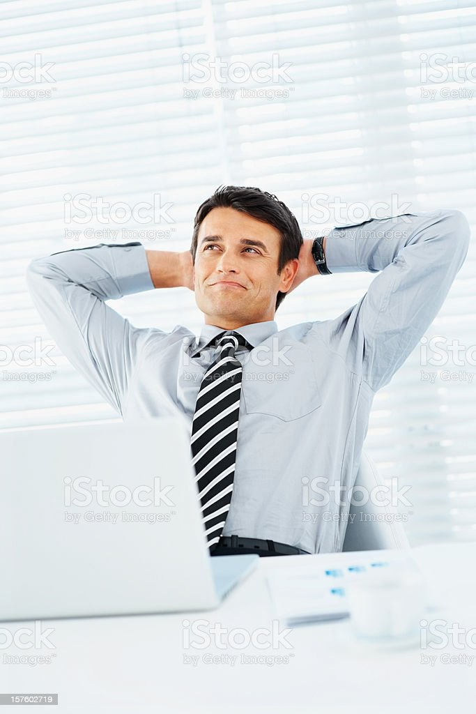 Success - Man with hands behind head at office royalty-free stock photo
