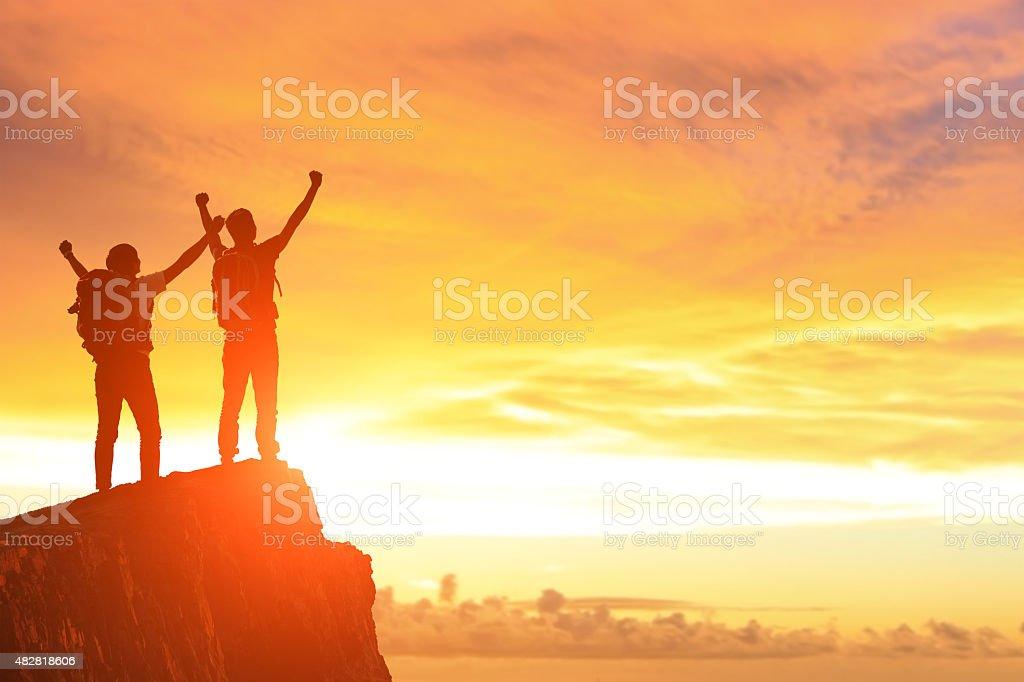Success men on the mountain stock photo
