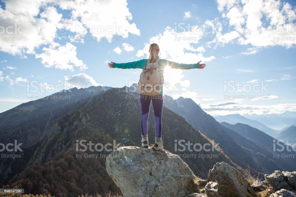 Success on mountain top stock photo