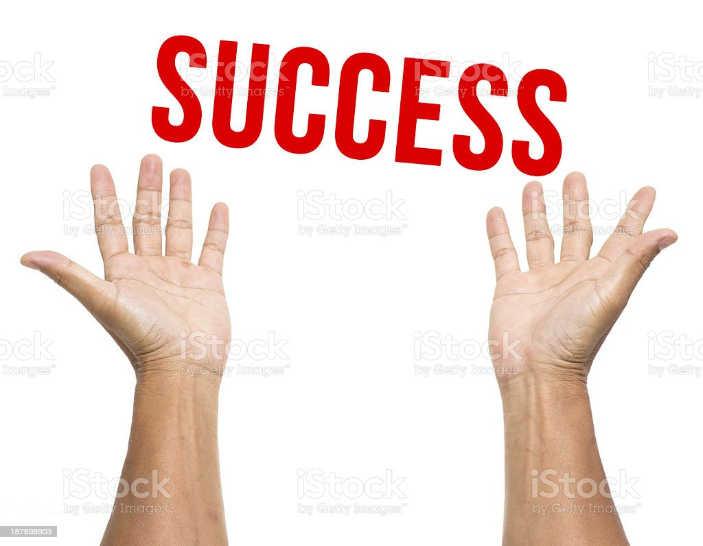 Success over two open hands isolated on white background stock photo