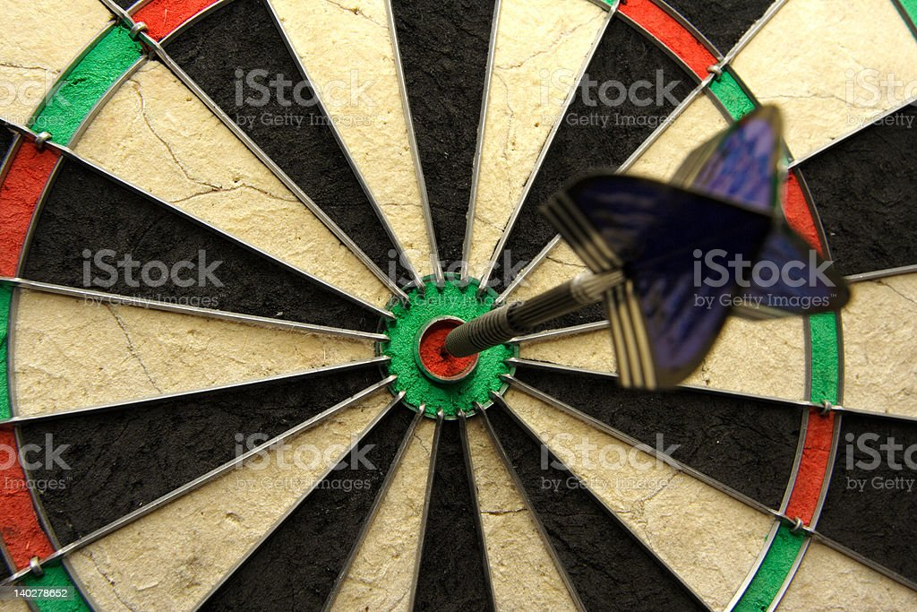 Success shot! Darts photo with arrow in bullseye royalty-free stock photo