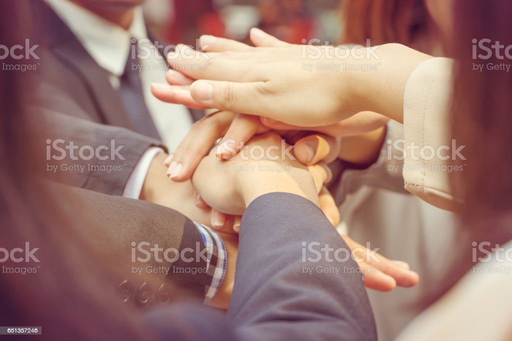 Success Teamwork Concept Business people joining hands city background. stock photo