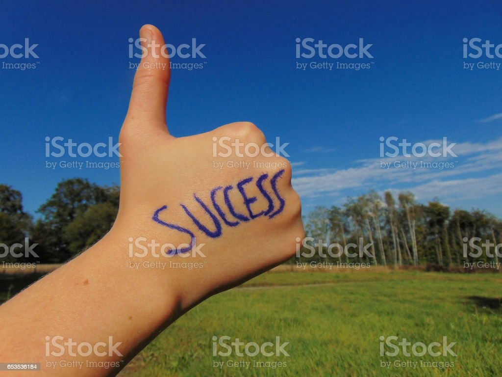 Success written on hand with thumb up stock photo