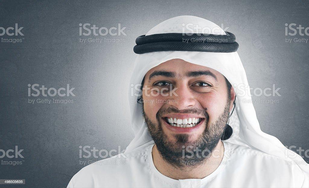 successful arabian businessman smiling stock photo