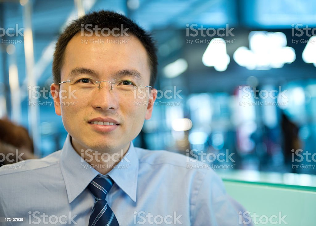 Successful Asian businessman with glasses royalty-free stock photo