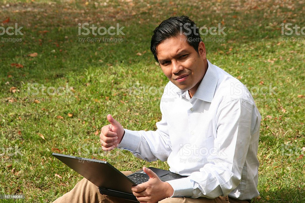 successful asian businessman with his laptop stock photo