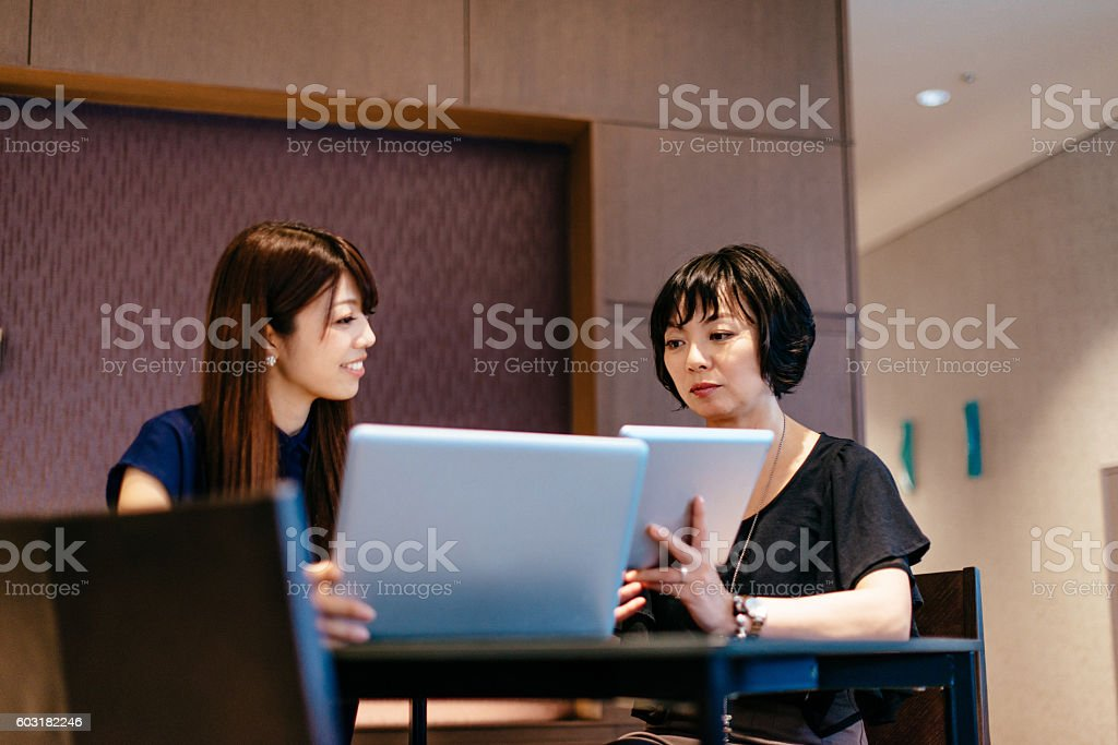 Successful Asian businesswomen in office at meeting stock photo
