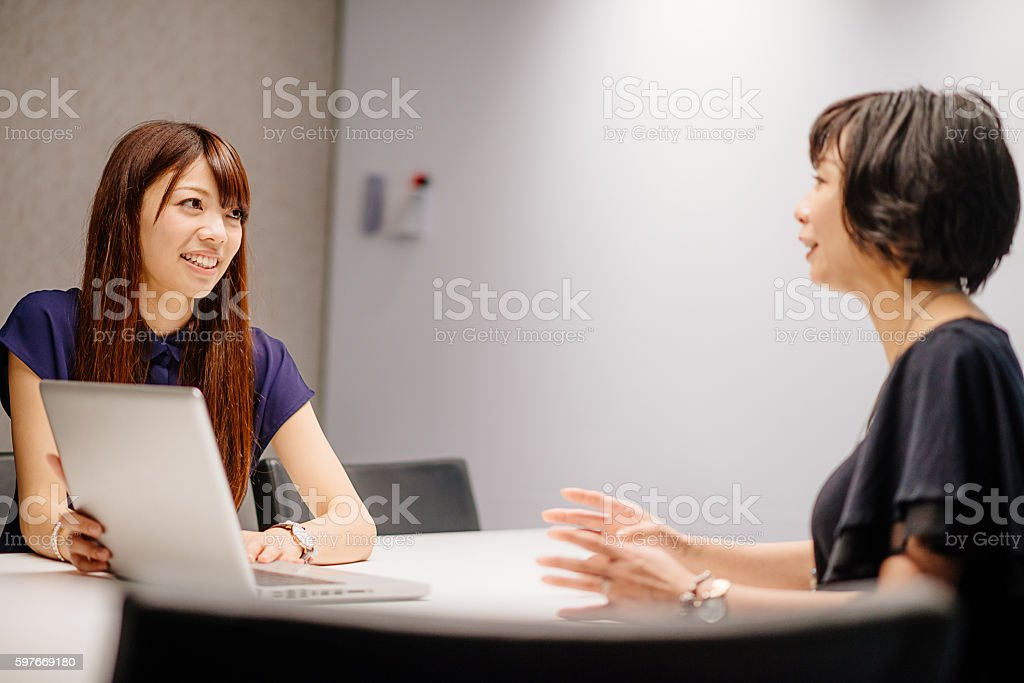 Successful Asian businesswomen in office stock photo