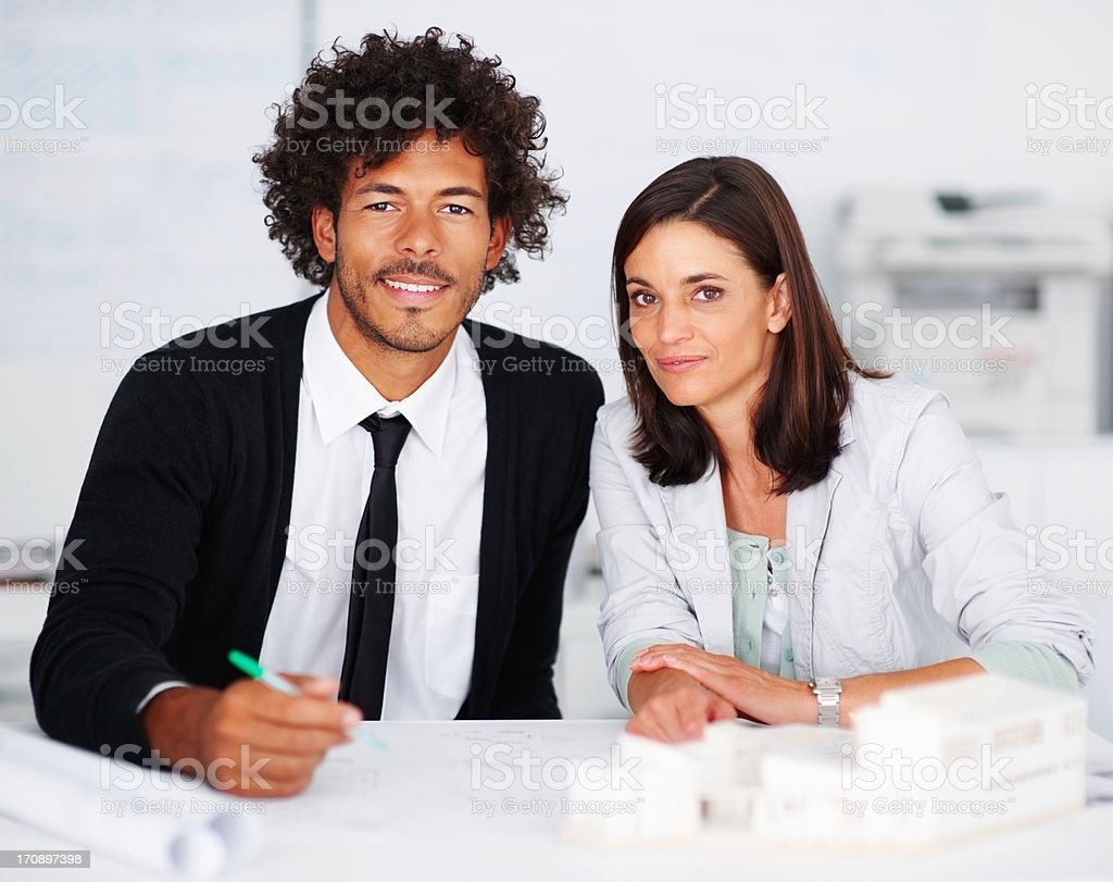 Successful business colleagues sitting together at the workplace stock photo
