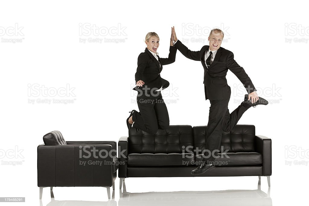 Successful business couple jumping royalty-free stock photo